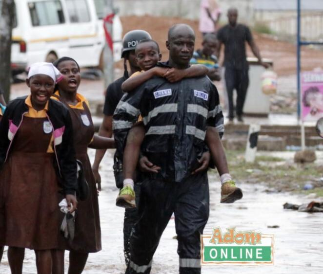 KOD surprises Police man who carried school children on his back during floods in Accra