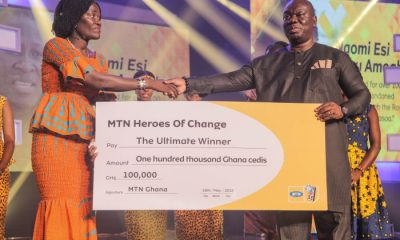 Madam Naomi Amoah Winner of MTN Heroes of Change Season 4 receiving her Dummy Cheque from Mr. Sam Addo GM of MTN Business