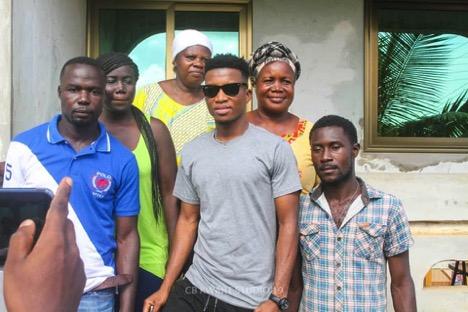 Kofi Kinaata with the Quayson family