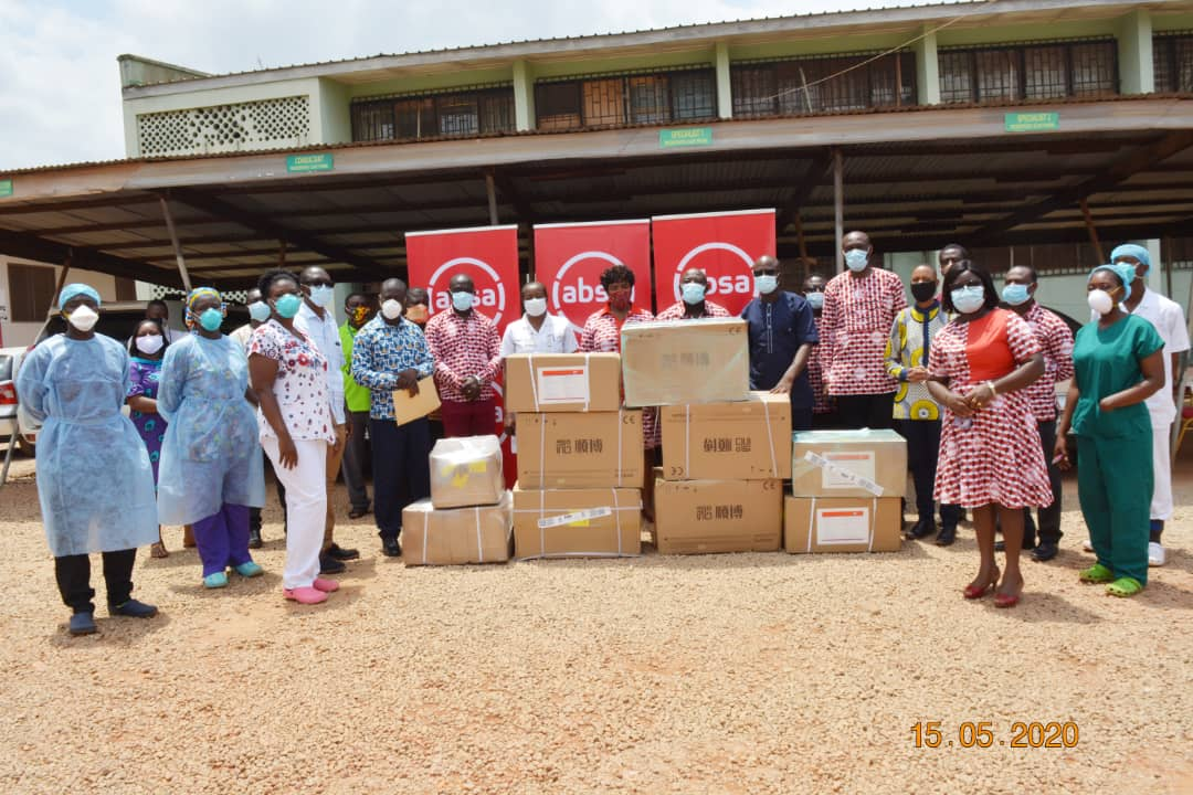 Officials of Absa Bank and Genser Energy donating medical supplies to the Kumasi South Hospital