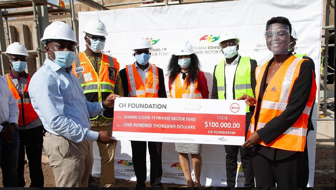 Cynthia Darko Acquaye, Group COO of CH Group Ltd.Presenting a cheque of $100,000 toDr. Justice Yankson Chairman of the Technical Committee of the Ghana COVID-19 Private Sector Fund, and General Secretary of the Ghana Medical Association