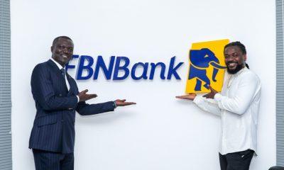 Victor Yaw Asante, FBNBank Ghana MD and Emmanuel Andrew Samini, *894# Product Ambassador