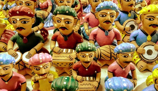 A group of toy figurines playing folk musical instruments