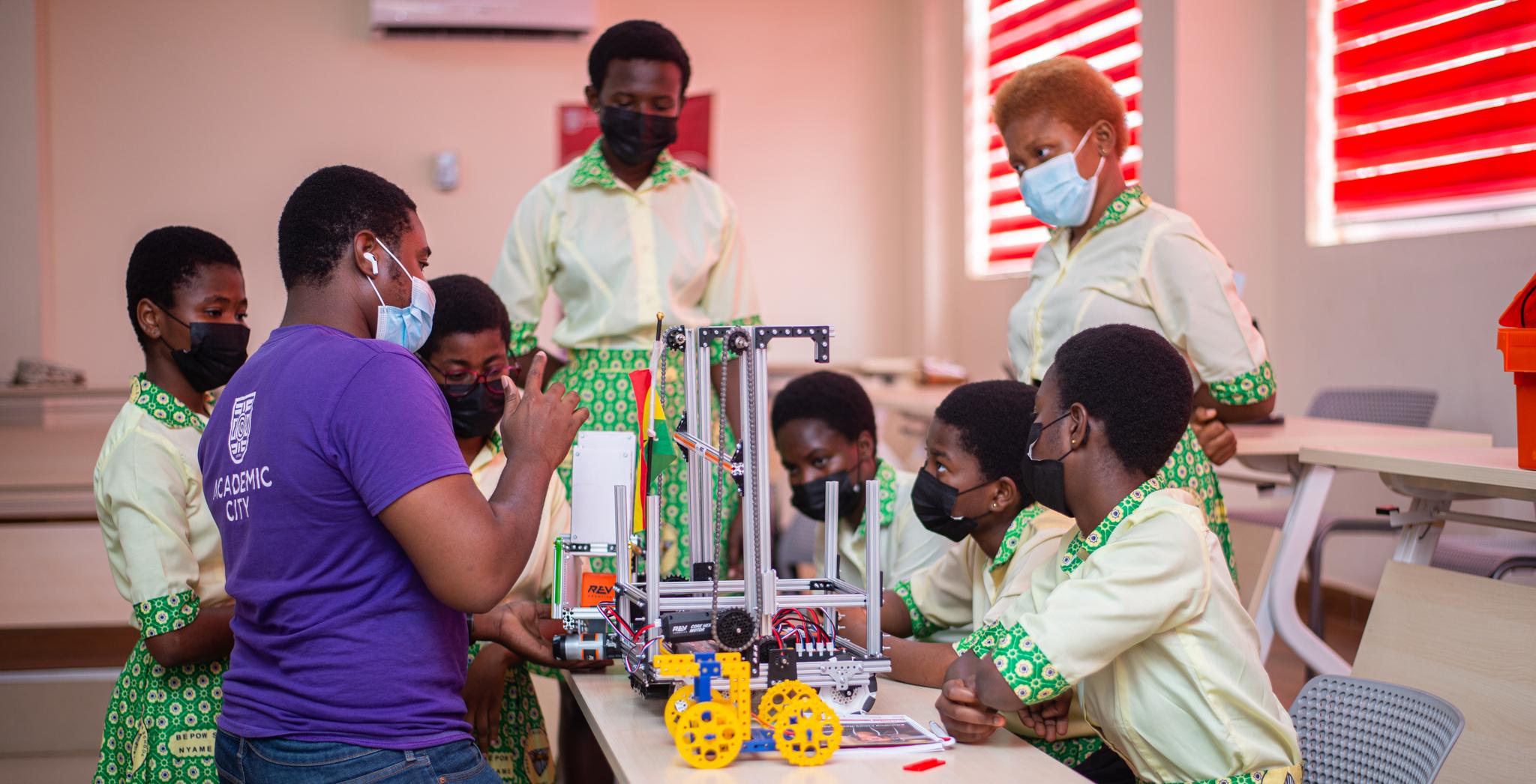 Mentor Benedict Amoako taking the girls through robotics lessons